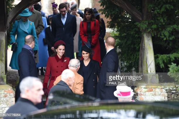 Britain's Catherine, Duchess of Cambridge and Meghan, Duchess of Sussex speak with Britain's Prince Charles, Prince of Wales as they depart after the...
