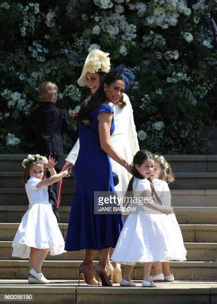 Britain's Catherine Duchess of Cambridge and Meghan Markle's friend Canadian fashion stylist Jessica Mulroney hold bridesmaids hands as they arrive...