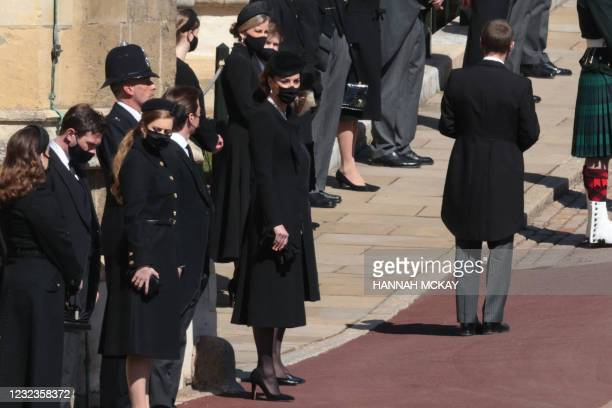 Britain's Catherine, Duchess of Cambridge and members of the Royal family stand outside St George's Chapel for the funeral service of Britain's...