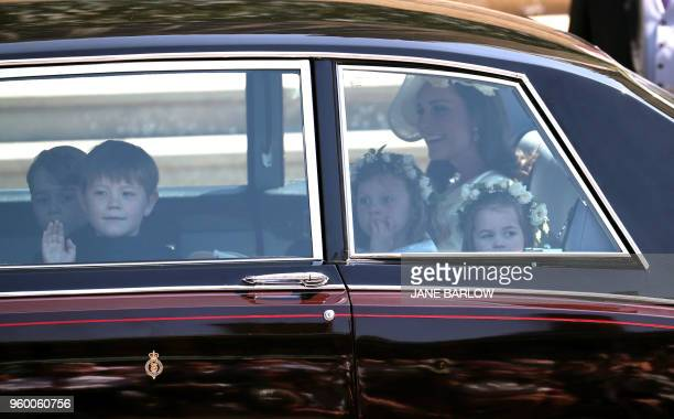 Britain's Catherine Duchess of Cambridge and Prince Harry's niece and bridesmaid Princess Charlotte arrive for the wedding ceremony of Britain's...