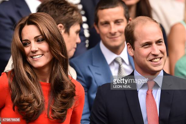 Britain's Catherine Duchess of Cambridge and Prince William Duke of Cambridge take their seats in the royal box on centre court to watch the men's...