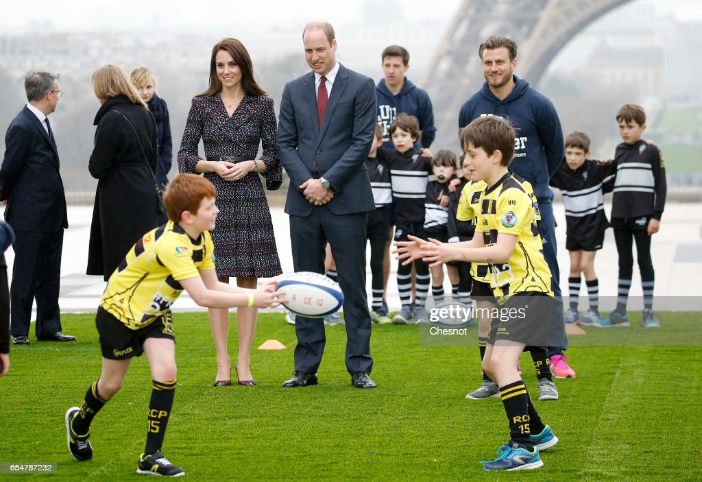 Britain's Catherine, Duchess of Cambridge and Prince William, Duke of Cambridge visit the Eiffel tower as they meet young French rugby fans at the Trocadero square near the Eiffel Tower on March 18, 2017 in Paris, France. The Duke and Duchess of Cambridge are on an official two-day visit to Paris.