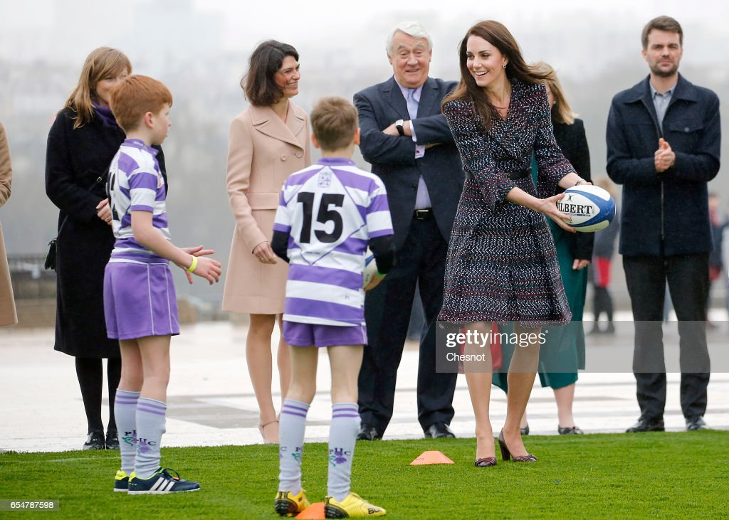 Britain's Catherine, Duchess of Cambridge and Prince William, Duke of Cambridge (not in picture) meet young French rugby fans at the Trocadero square near the Eiffel Tower on March 18, 2017 in Paris, France. The Duke and Duchess of Cambridge are on an official two-day visit to Paris.