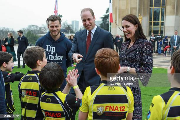 Britain's Catherine Duchess of Cambridge and Prince William Duke of Cambridge meet young Rugby players during the 'Les Voisins in Action' event...
