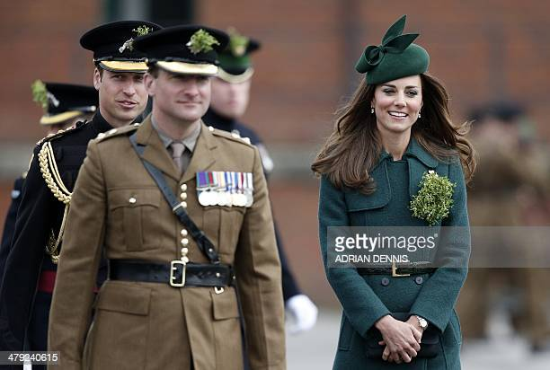 Britain's Catherine Duchess of Cambridge and Prince William the Duke of Cambridge walk across the parade ground while visiting the Irish Guards...