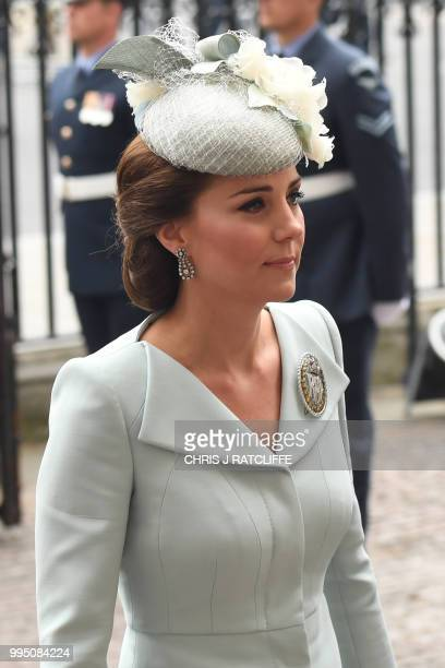 Britain's Catherine Duchess of Cambridge arrives for a service to mark the centenary of the Royal Air Force at Westminster Abbey in central London on...