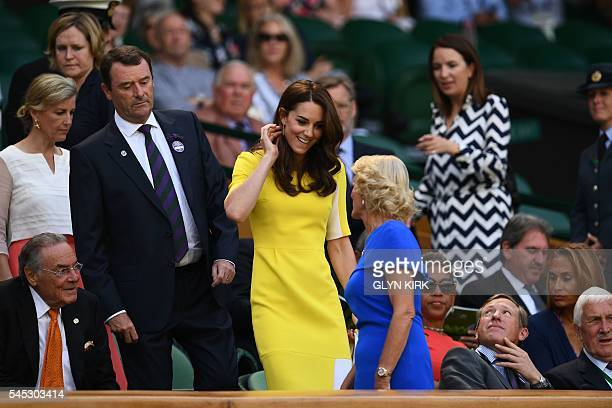 Britain's Catherine Duchess of Cambridge arrives in the royal box on centre court to watch the women's semifinal match between US player Serena...
