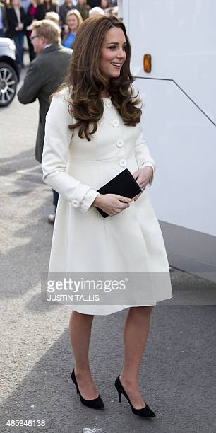 Britain's Catherine Duchess of Cambridge arrives on the set of British television series Downton Abbey at Ealing Studios in west London on March 12...