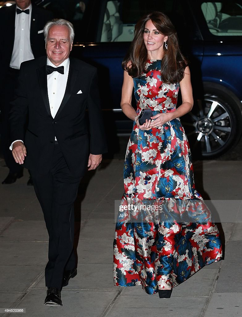 Britain's Catherine, Duchess of Cambridge (R) arrives to attend the 100 Women in Hedge Funds (100WHF) Gala Dinner, in aid of The Art Room, at the Victoria and Albert (V&A) Museum in London on October 27, 2015. The Duchess is Patron of the 100 Women in Hedge Funds' Philanthropic Initiatives.