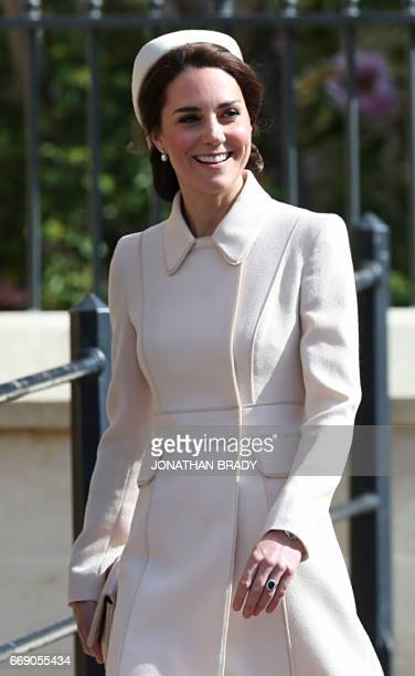 Britain's Catherine Duchess of Cambridge arrives to attend the Easter Sunday service at St George's Chapel Windsor Castle west of London on April 16...