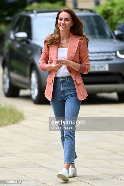 Britain's Catherine, Duchess of Cambridge, arrives to visit to the Urban Nature Project at the Natural History Museum in central London on June 22,...