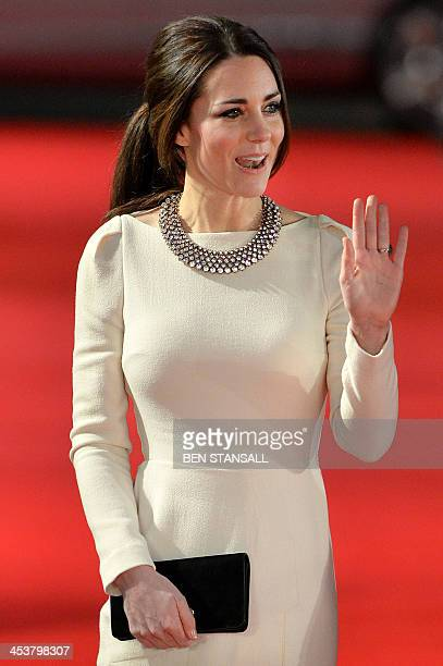 """Britain's Catherine, Duchess of Cambridge, arrives with Prince William, Duke of Cambridge , to attend the royal film premier of """"Mandela: Long Walk..."""