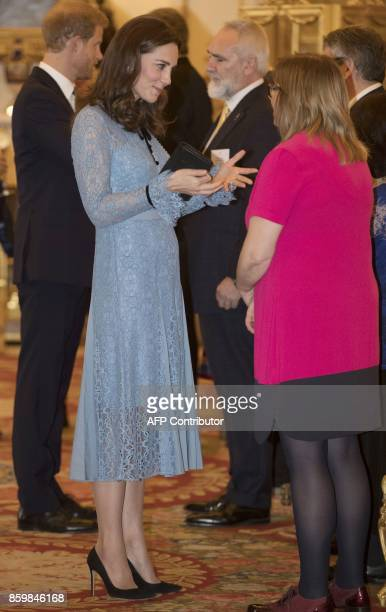 Britain's Catherine Duchess of Cambridge attends a reception at Buckingham Palace to celebrate World Mental Health Day in central London on October...