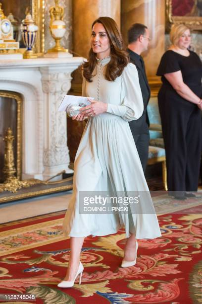 Britain's Catherine, Duchess of Cambridge, attends a reception to mark the 50th Anniversary of the investiture of The Prince of Wales at Buckingham...
