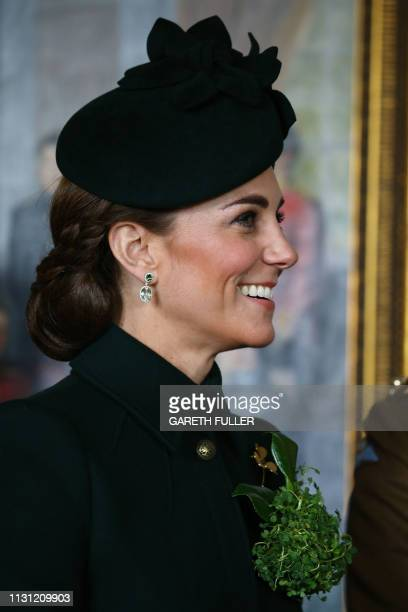 Britain's Catherine Duchess of Cambridge attends the St Patrick's Day parade to present shamrock to officers and guardsmen of 1st Battalion the Irish...
