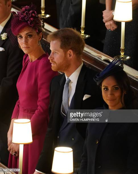 Britain's Catherine Duchess of Cambridge Britain's Prince Harry Duke of Sussex and Meghan Duchess of Sussex react during the wedding ceremony of...