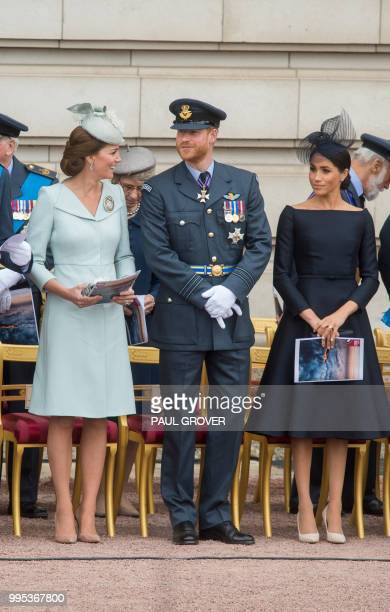 Britain's Catherine Duchess of Cambridge Britain's Prince Harry Duke of Sussex and Britain's Meghan Duchess of Sussex attend a ceremony to present a...