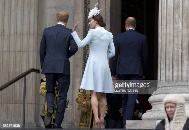 Britain's Catherine, Duchess of Cambridge , Britain's Prince William, Duke of Cambridge and Prince Harry arrive to attend a national service of...