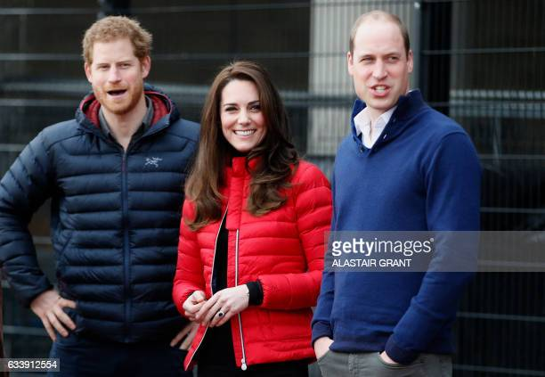 Britain's Catherine Duchess of Cambridge Britain's Prince William Duke of Cambridge and Britain's Prince Harry look down the track as they attend a...