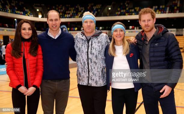 Britain's Catherine Duchess of Cambridge Britain's Prince William Duke of Cambridge former athletes Iwan Thomas and Paula Radcliffe and Britain's...