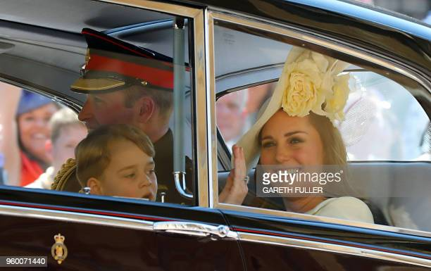 Britain's Catherine Duchess of Cambridge Britain's Prince William Duke of Cambridge and Prince Harry's nephew and page boy Prince George leave after...