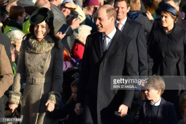 Britain's Catherine, Duchess of Cambridge, Britain's Princess Charlotte of Cambridge, Britain's Prince William, Duke of Cambridge, and Britain's...