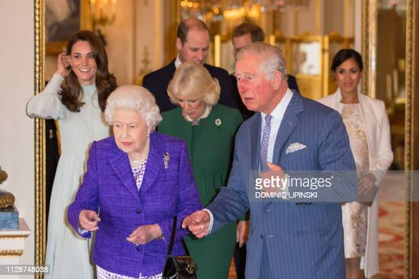 Britain's Catherine, Duchess of Cambridge, Britain's Queen Elizabeth II, Britain's Prince William, Duke of Cambridge, Britain's Camilla, Duchess of...