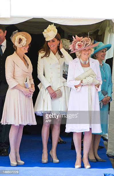 Britain's Catherine Duchess of Cambridge Camilla Duchess of Cornwall and Sophie Countess of Wessex watch the annual procession of members of the...