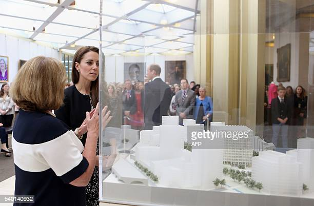 Britain's Catherine Duchess of Cambridge chats with Elizabeth Dibble deputy chief of mission as they look at a model of the new US Embassy after she...