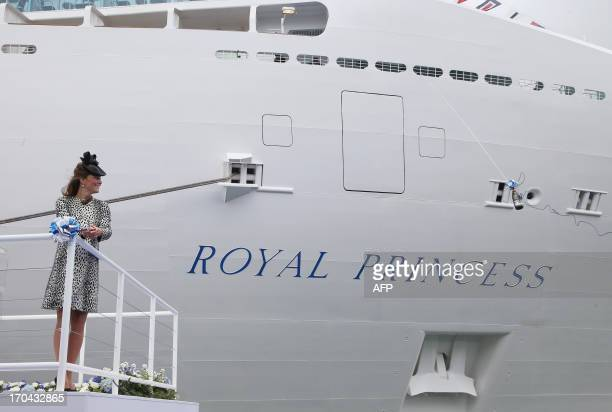 Britain's Catherine Duchess of Cambridge cuts the rope to release the bottle of champagne to officially name Princess Cruises's new ship 'Royal...