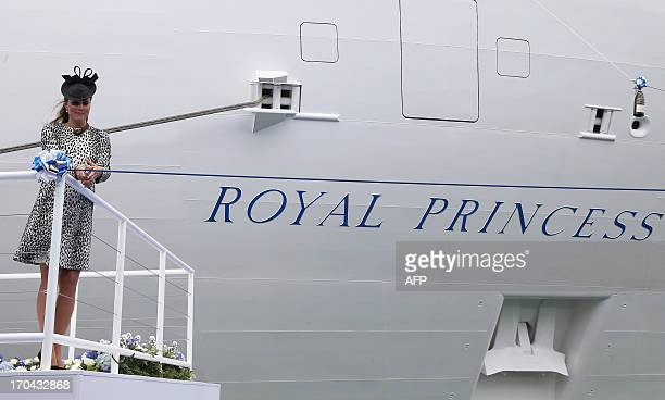 Britain's Catherine, Duchess of Cambridge cuts the rope to release the bottle of champagne to officially name Princess Cruises's new ship 'Royal...