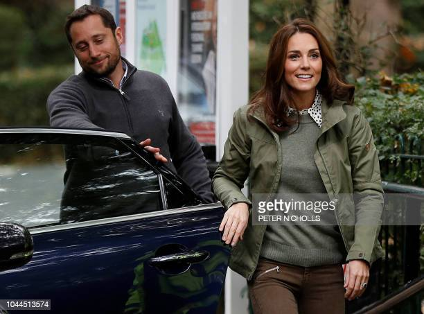 Britain's Catherine Duchess of Cambridge exits a car as she arrives to visit Sayers Croft Forest School and Wildlife Garden in London on October 2...