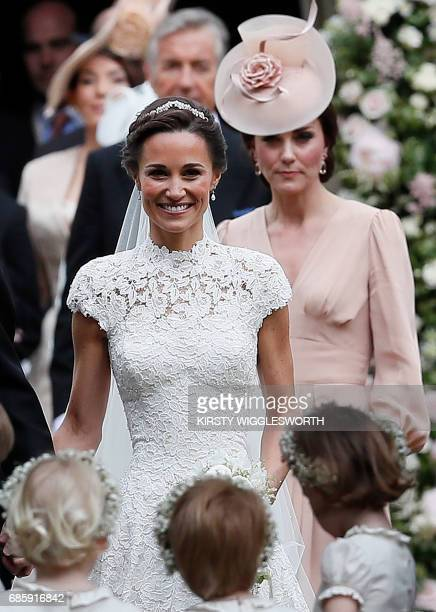 Britain's Catherine Duchess of Cambridge follows her sister Pippa Middleton following the wedding of Middleton to James Matthews at St Mark's Church...