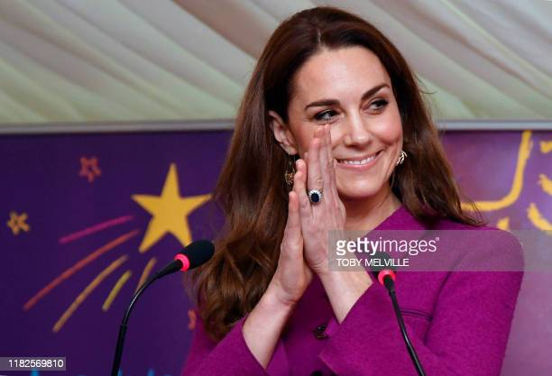 Britain's Catherine Duchess of Cambridge gestures as she delivers a speech officially opening the Nook Children's Hospice south of Norwich Eastern...