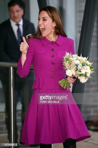 Britain's Catherine Duchess of Cambridge gestures as she leaves after visiting the Nook Children's Hospice south of Norwich Eastern England on...
