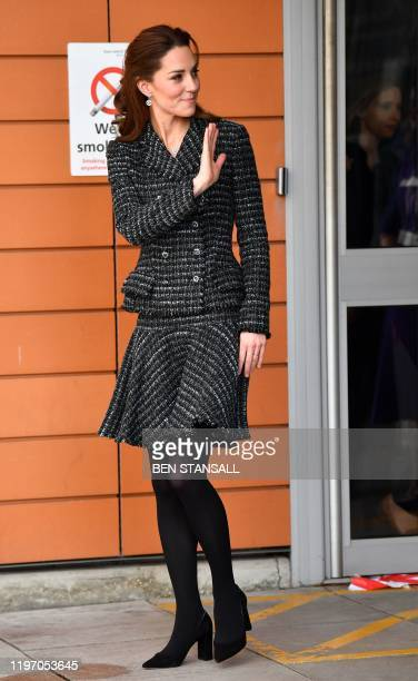 Britain's Catherine, Duchess of Cambridge gestures as she leaves after a visit to the Evelina London Childrens Hospital in London on January 28, 2020...