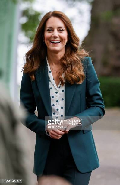 Britain's Catherine, Duchess of Cambridge gestures as she visits Starbank Park to hear about the work of Fields in Trust, along with Britain's Prince...