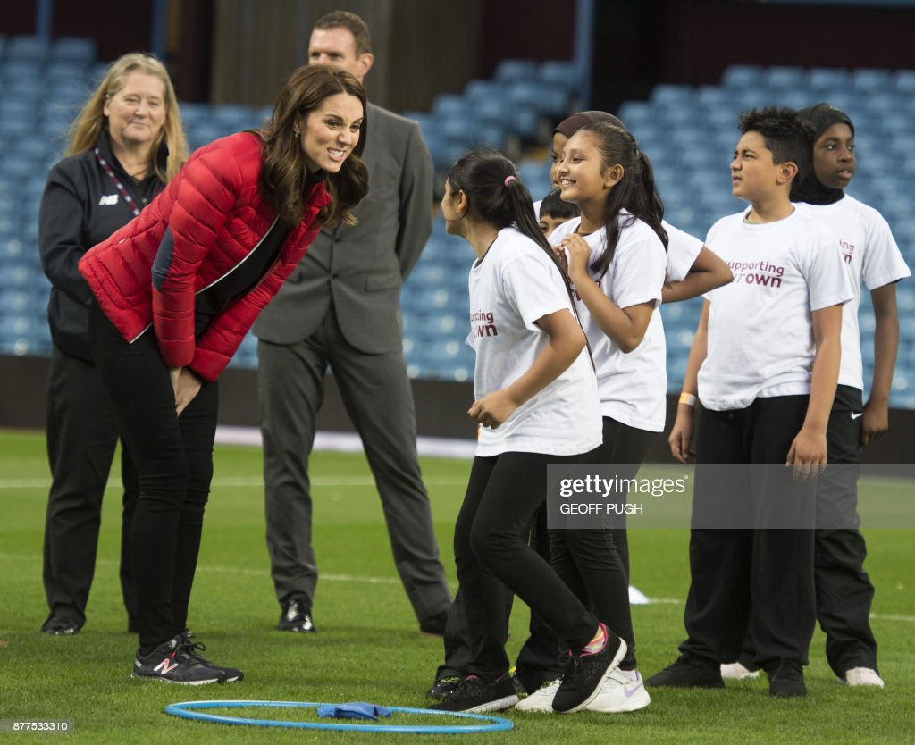 Britain's Catherine, Duchess of Cambridge gestures during a visit to the Aston Villa Football Club to see the work of the Coach Core programme, in Birmingham on November 22, 2017. / AFP PHOTO / POOL / Geoff Pugh