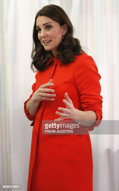 Britain's Catherine Duchess of Cambridge gestures during her visit to officially open the Mittal Children's Medical Centre home to the new Premier...