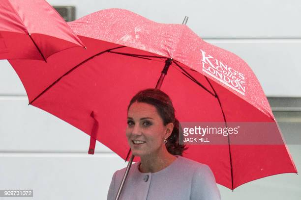 Britain's Catherine, Duchess of Cambridge gestures during her visit to The Maurice Wohl Clinical Neuroscience Institute at the Institute of...