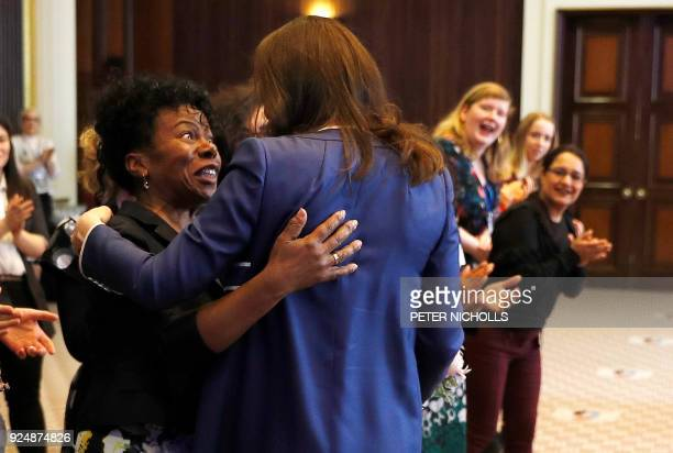 Britain's Catherine Duchess of Cambridge greets Professor Jacqueline DunkleyBent one of the midwives who helped to deliver her daughter Princess...