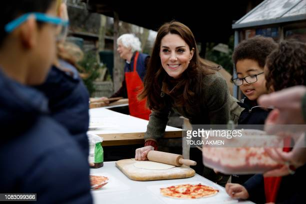 Britain's Catherine, Duchess of Cambridge helps make pizza as she visits the Islington community garden in north London on January 15, 2019.