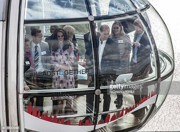 Britain's Catherine Duchess of Cambridge her husband Britain's Prince William Duke of Cambridge and his brother Britain's Prince Harry travel in a...
