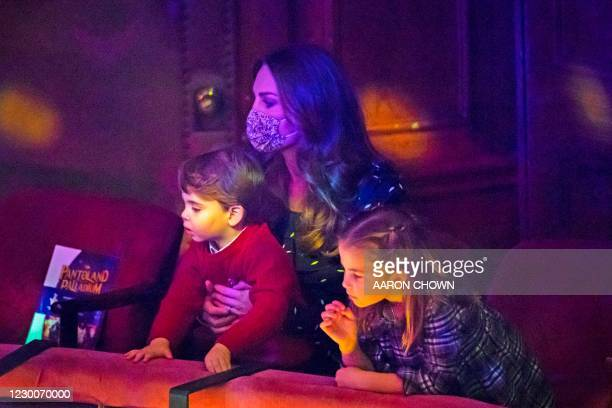 Britain's Catherine, Duchess of Cambridge holds Britain's Prince Louis of Cambridge as Britain's Princess Charlotte of Cambridge looks on at a...