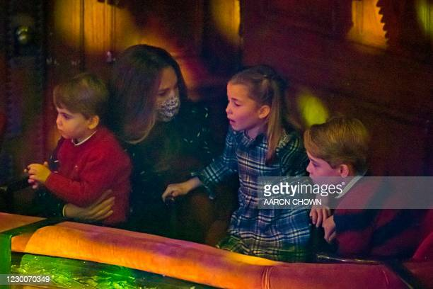 Britain's Catherine, Duchess of Cambridge holds Britain's Prince Louis of Cambridge as she speaks with Britain's Princess Charlotte of Cambridge and...