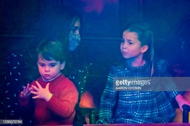 Britain's Catherine, Duchess of Cambridge holds Britain's Prince Louis of Cambridge as she speaks with Britain's Princess Charlotte of Cambridge...