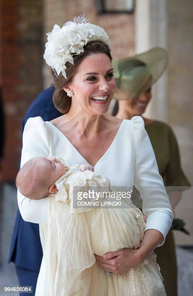 Britain's Catherine Duchess of Cambridge holds Britain's Prince Louis of Cambridge on their arrival for his christening service at the Chapel Royal...