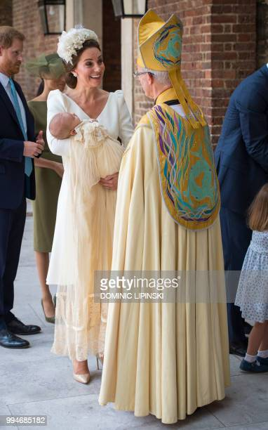 Britain's Catherine Duchess of Cambridge holds Britain's Prince Louis of Cambridge as she speaks to Archbishop of Canterbury Justin Welby on their...