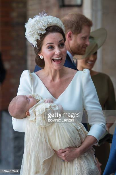 Britain's Catherine, Duchess of Cambridge holds Britain's Prince Louis of Cambridge on their arrival for his christening service at the Chapel Royal,...
