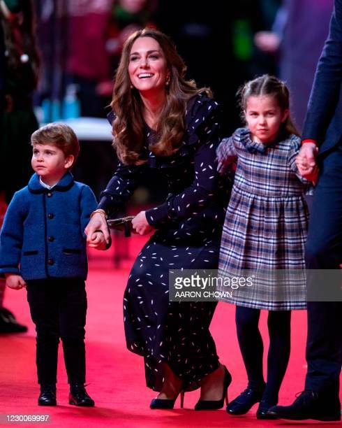 Britain's Catherine, Duchess of Cambridge , holds the hand of her son, Britain's Prince Louis of Cambridge and her daughter Britain's Princess...